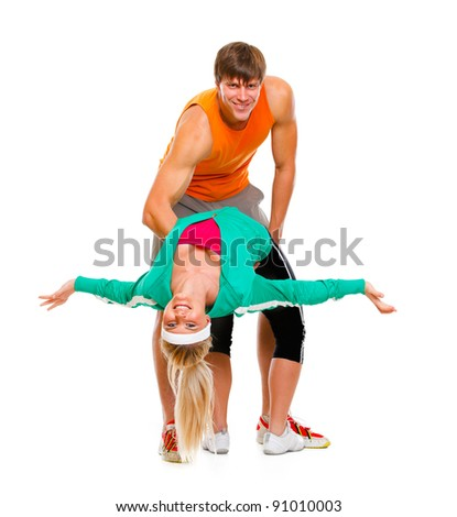 Fit young female and guy in sportswear having fun isolated on white - stock photo
