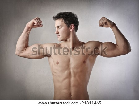 Fit young man showing his muscles - stock photo