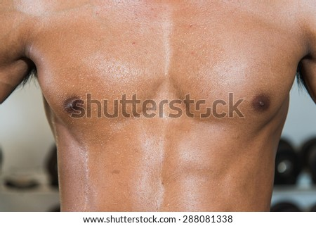 Fit young man sweating after exercise - stock photo