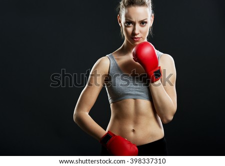 Fit, young woman boxer, black background - stock photo