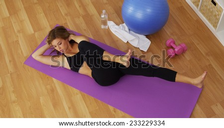 Fit young woman exercising in home gym - stock photo