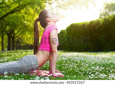 Fit young woman exercising outdoors, healthy lifestyle