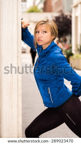 Fit young woman in urban environment of large city