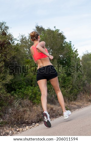 Fit young woman jogging or running outdoors