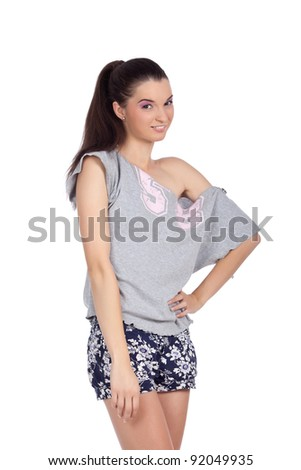Fit young woman posing and smiling in casual clothes. High resolution image taken in studio. Isolated on pure white background with copy space for your ad.