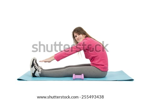 Fit young woman stretching on her exercise mat against a white background - stock photo