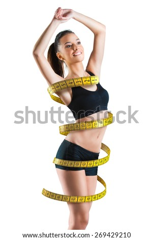 Fit young woman with a large measuring tape around her body - stock photo