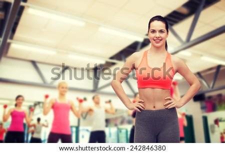 fitness and diet concept - smiling teenage girl in sportswear - stock photo