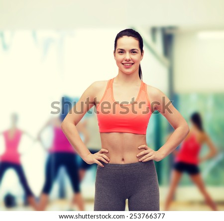 Fitness And T Concept Smiling Teenage Girl In Sportswear