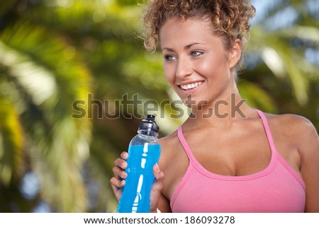 fitness and dieting concept - smiling sporty woman with bottle of water
