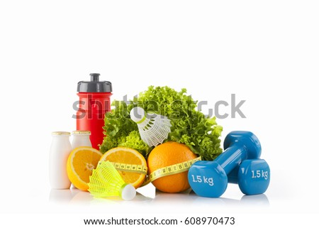Fitness and pilates concept.Healthy food and sport equipment on the white background.