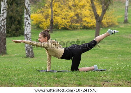 Fitness and stretching exercises outdoor. Beautiful  - stock photo