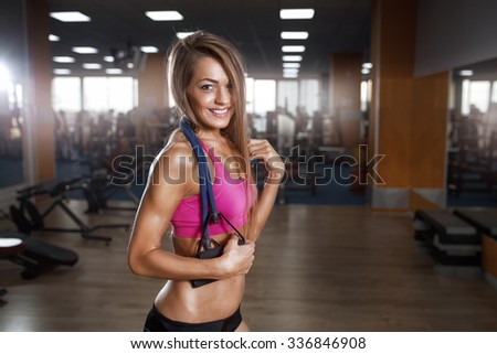Fitness beautiful woman execute exercise with expander in gym. Stretch Band - stock photo