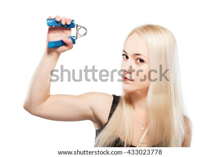 Fitness blond girl exercising her arm with a spring grip tool - stock photo