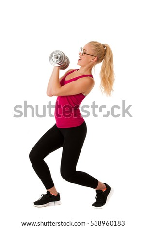 Fitness - Blonde young woman working out with dumbbells isolated over white