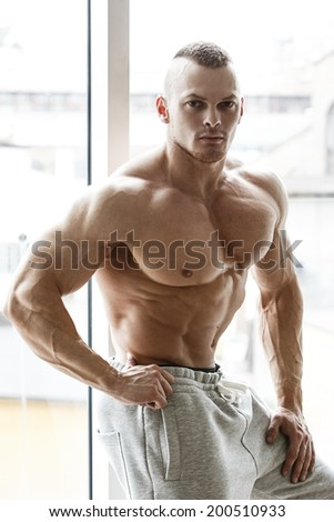 Fitness, bodybuilding. Powerful man with perfect body