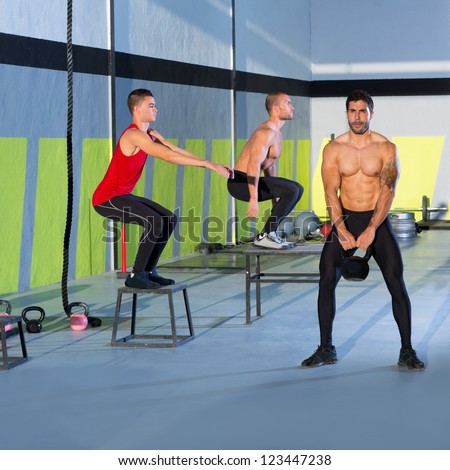 Fitness box jump people group and kettlebell man at gym - stock photo