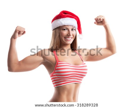 Fitness christmas woman wearing santa hat. Female model working out smiling happy and excited isolated on white background.