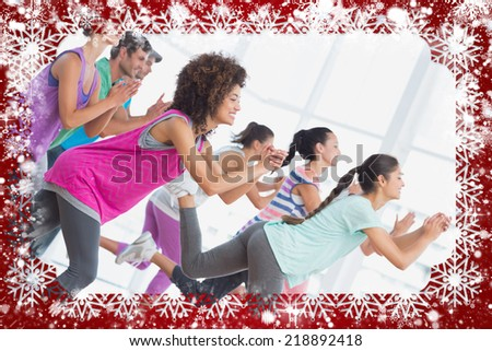 Fitness class and instructor doing pilates exercise against snow - stock photo