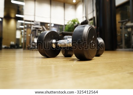 Fitness club weight training equipment gym concept. - stock photo