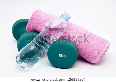 Fitness  concept - dumbbells, water bottle and towel - stock photo
