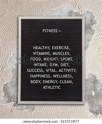 Fitness concept in plastic letters on very old menu board, vintage look