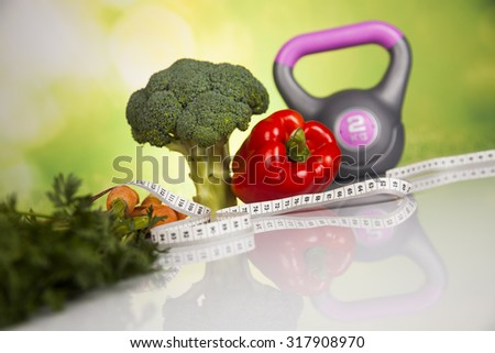 Fitness concept with dumbbells and food - stock photo