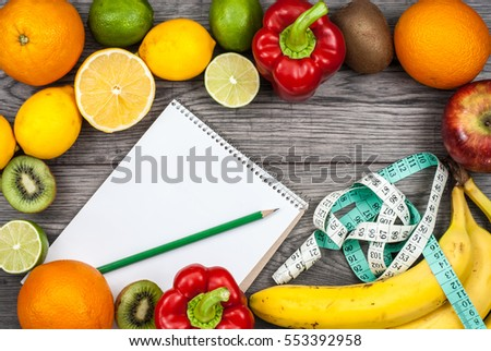 Fitness concept with fruit and text book. Top view background fitness concept.
