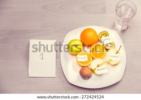Fitness concept with healthy dieting.Concept of diet.Low-calorie fruit diet.Diet for weight loss.Plate with fruit on the table.Vegetarian diet for weight loss.Healthy meals for the summer diet - stock photo
