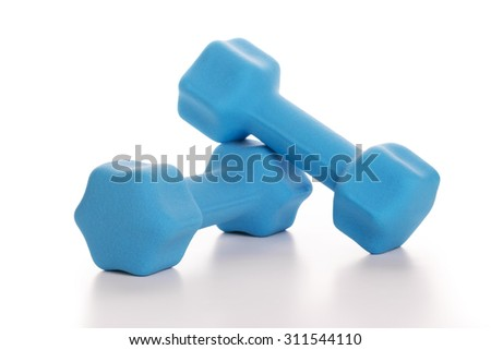 Fitness concept with two blue dumbbells on white background, closeup  - stock photo