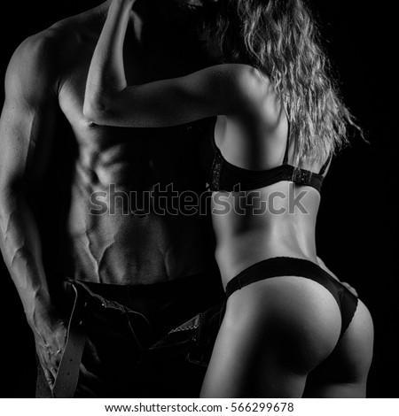 Fitness couple hugging. Black and white