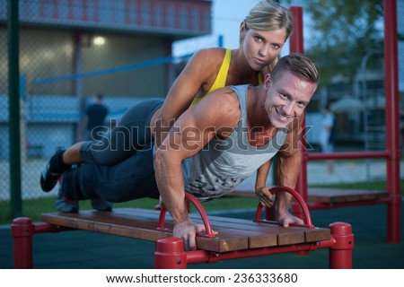 Fitness couple on a street workout outdoors - stock photo