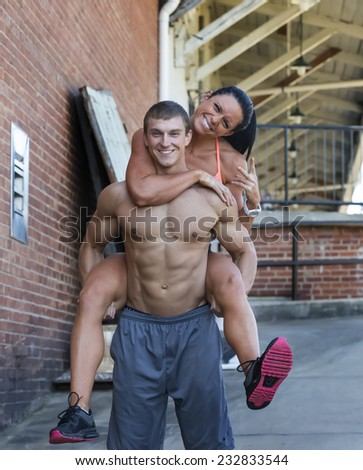 Fitness couple posing in an outdoor environment - stock photo