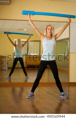 Fitness dance class aerobics. Women dancing happy energetic in gym fitness class