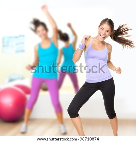 Fitness dance studio class. Dancing woman in gym during exercise dancer workout training with happy fresh energy. - stock photo