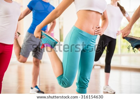 Fitness dance studio class. Group of people are exercising in dance studio. - stock photo