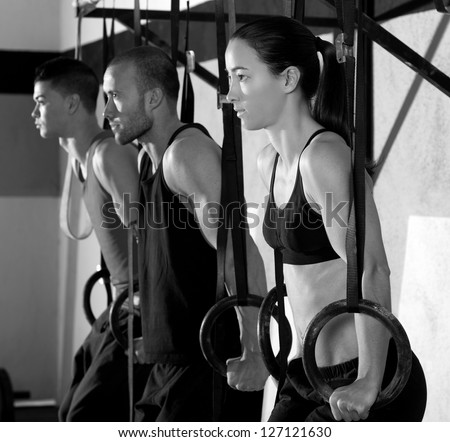 Fitness dip ring group workout at gym dipping in a row exercise - stock photo