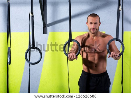 Fitness dip ring man relaxed after workout at gym dipping exercise - stock photo
