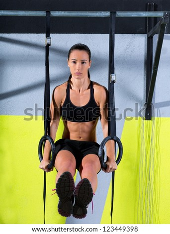 Fitness dip ring woman workout at gym dipping exercise - stock photo