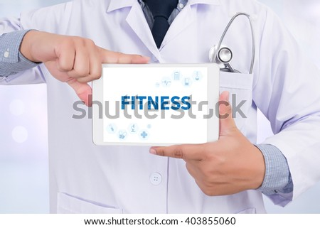 FITNESS Doctor holding  digital tablet