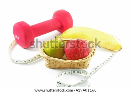 Fitness dumbbells and fruits. Fresh red tasty apple,orange and banana with measuring tape isolated on white - stock photo