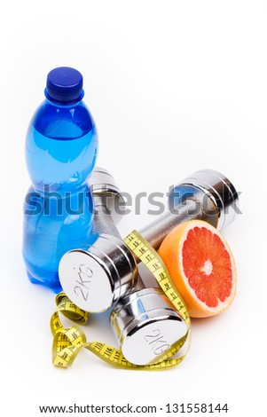 fitness dumbbells  and fruits isolated on white - stock photo