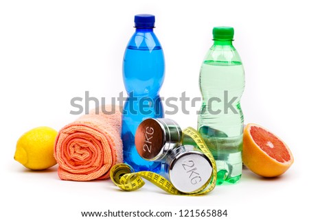 fitness dumbbells water and fruits - stock photo