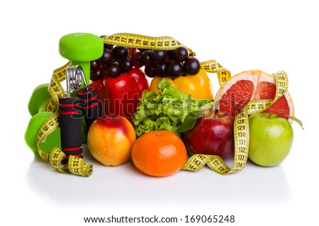 fitness equipment and healthy food isolated on white (green and red apples, pepper, grapes, grapefruit, parsley, nectarines, dumbbells and measuring tape) - stock photo