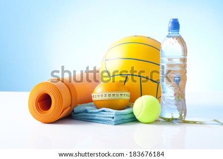 fitness equipment including yoga mat and sport ball - stock photo