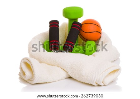 fitness equipment isolated on white (towel, two green dumbbells, simulator for hand, ball and bottle of water) - stock photo