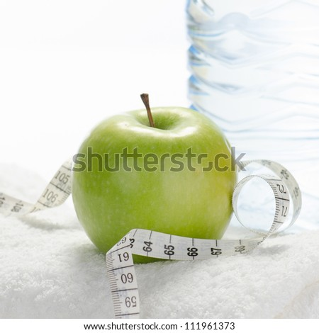Fitness equipment towel, apple, water, measuring tape