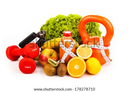 fitness equipment with fruits and bottle of energy drink isolate