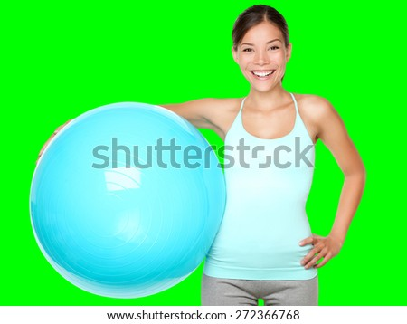 Fitness exercise woman holding pilates ball ready for exercising. Isolated cutout on green chroma key background. - stock photo