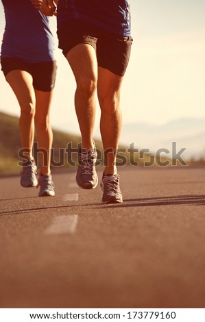 fitness exercising couple training for marathon running lifestyle - stock photo